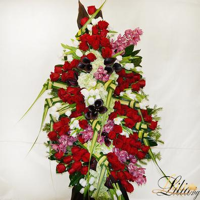 Funeral wreath with red roses, tulips, calla, orchid and hydrangea